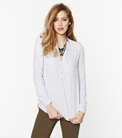 You'll love the softness of this light wash polo blouse! Dress it up with soft pants for work.