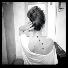 Bird tattoo...simple & pretty.