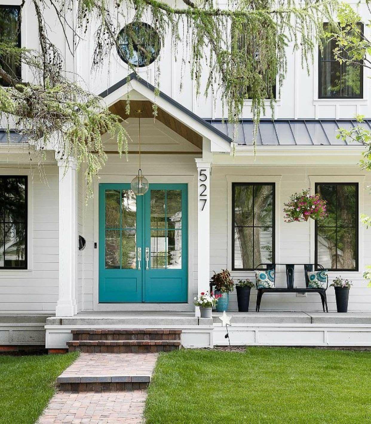 Farmhouse exterior. White House with black window trim