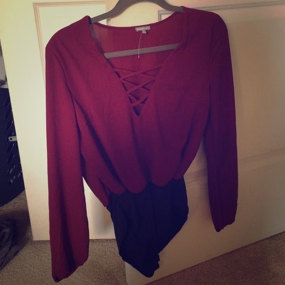 Charlotte Reusse criss-cross bodysuit Size small, criss-cross body suit design with snaps on the bottom. Comfy. To be worn with a skirt or jeans Charlotte Russe Tops Blouses