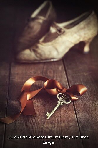 Trevillion Images - decorative-key-with-old-shoes