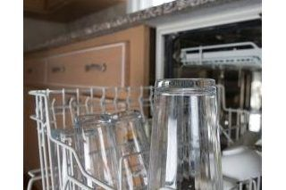 How To Stop White Residue On Dishes From A Dishwasher Hunker Dishwasher Soap Clean Dishwasher Cleaning Your Dishwasher