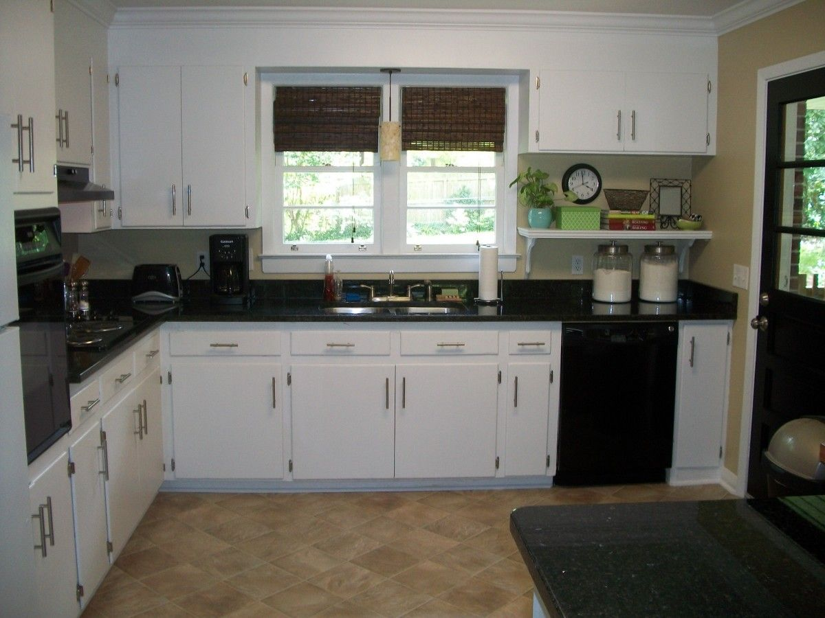 Kitchen Cabinets White Cabinetry With Black Granite Countertop Also Marble  Flooring Tile Also Drawers And Lockers Storages Also Panel Appliances Also  Window ...