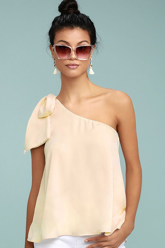641b4774bb1370 The Apolline Cream One-Shoulder Top is what every fashionista s dreams are  made of! Silky woven fabric ties at the right shoulder