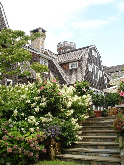 Christie Brinkley's lovely house with herbaceous border and bluestone stair