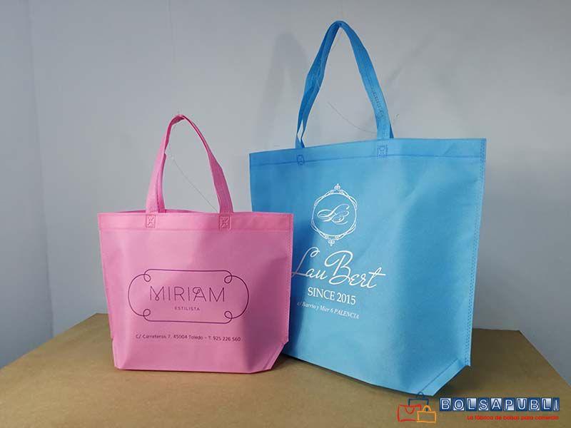 009bd40b6 Bolsas de tela TNT, tejido sin tejer en color rosa y azul con logo  personalizado