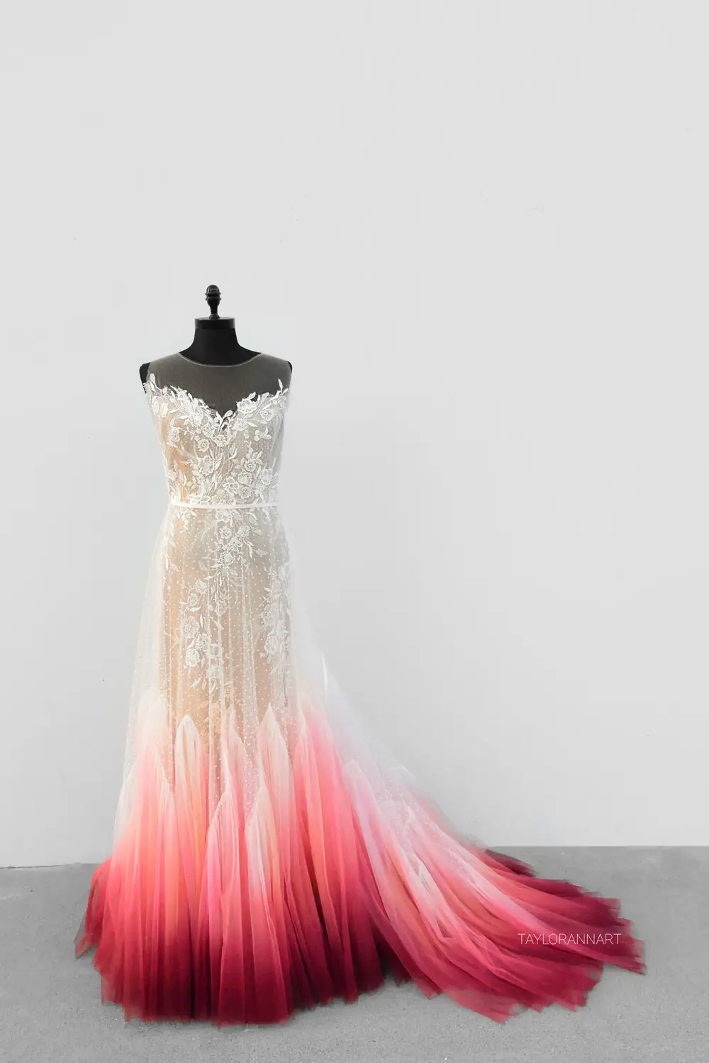 An artist airbrushes wedding dresses, and you can buy one of her colorful creations for your special day