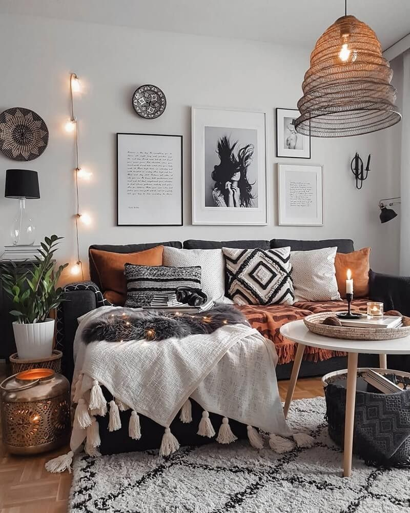 Photo of Boho dark grey and white interior in this room is encompassed by agreeable seats…