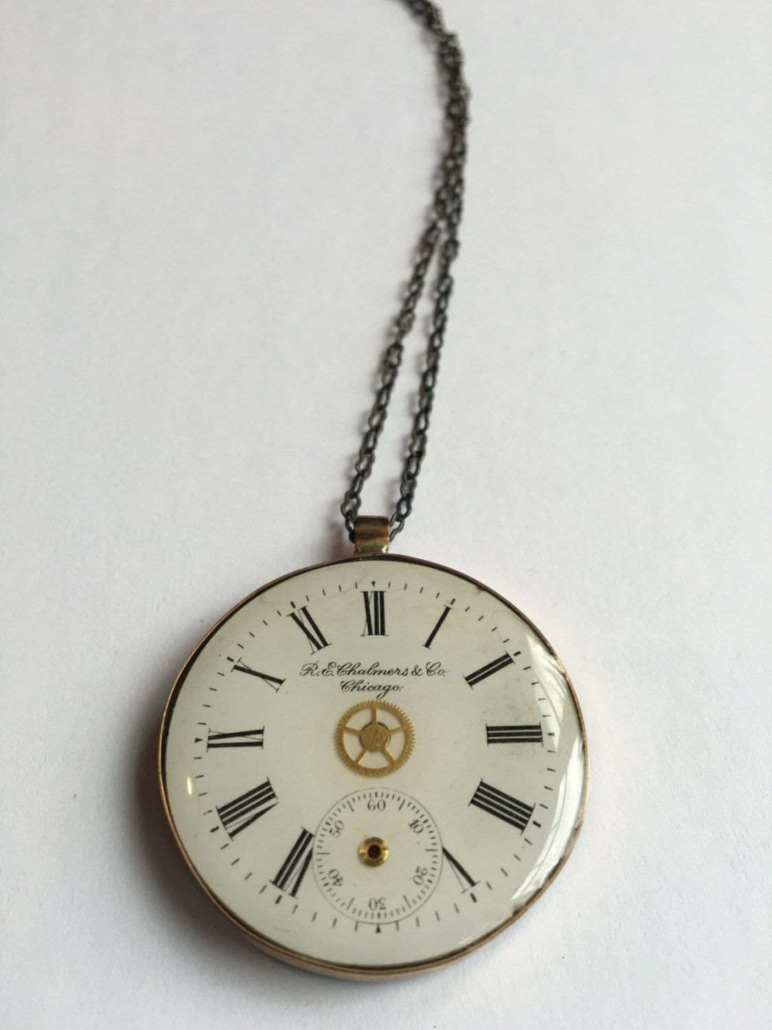 """Handmade Double Sided Open Bezel Pendant Featuring Vintage Watch Parts and the word """"Imagine"""" by ajunkersjournal on Etsy"""