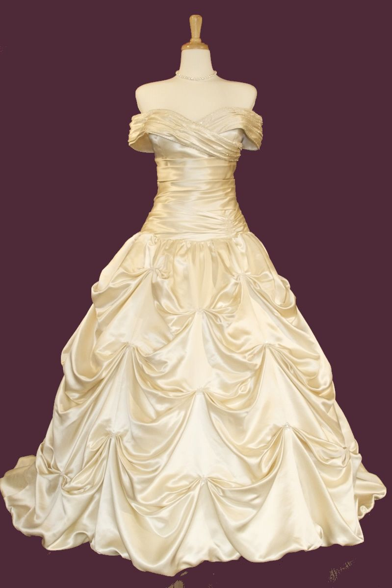 Strapless taffeta trumpet gown with catch-up gown
