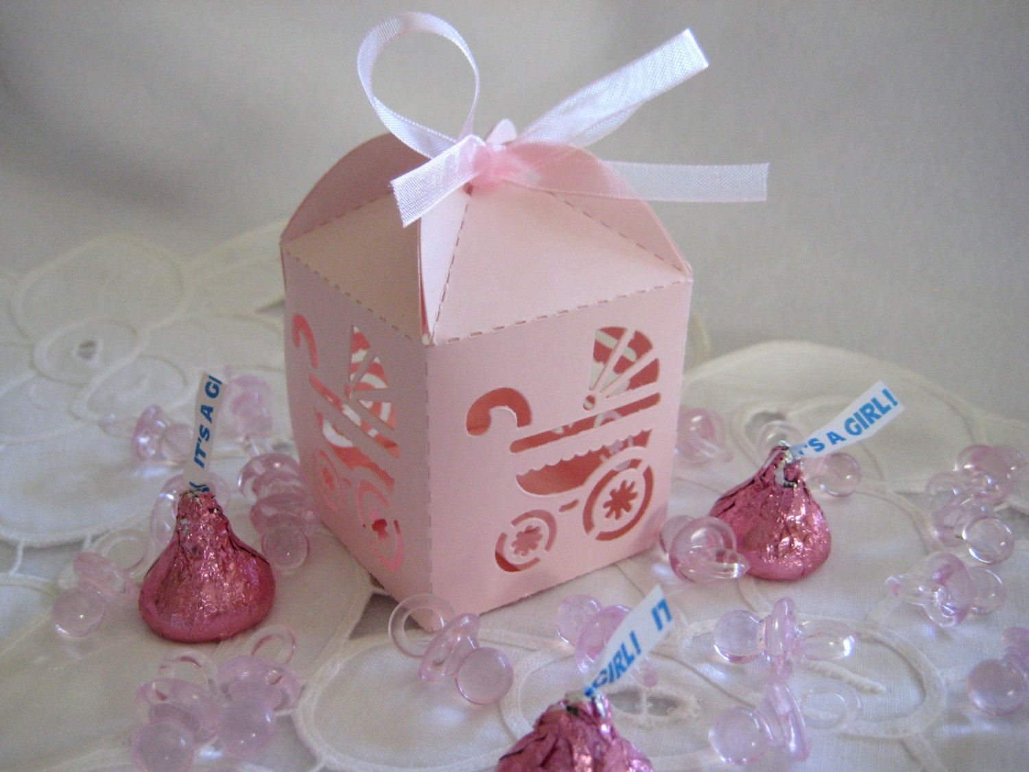 Pink, Laser-Cut Baby Carriage Party Favor Boxes for Baby Shower Favors, Christening Favors, Baptism Favors - set of 12. $5.95, via Etsy.