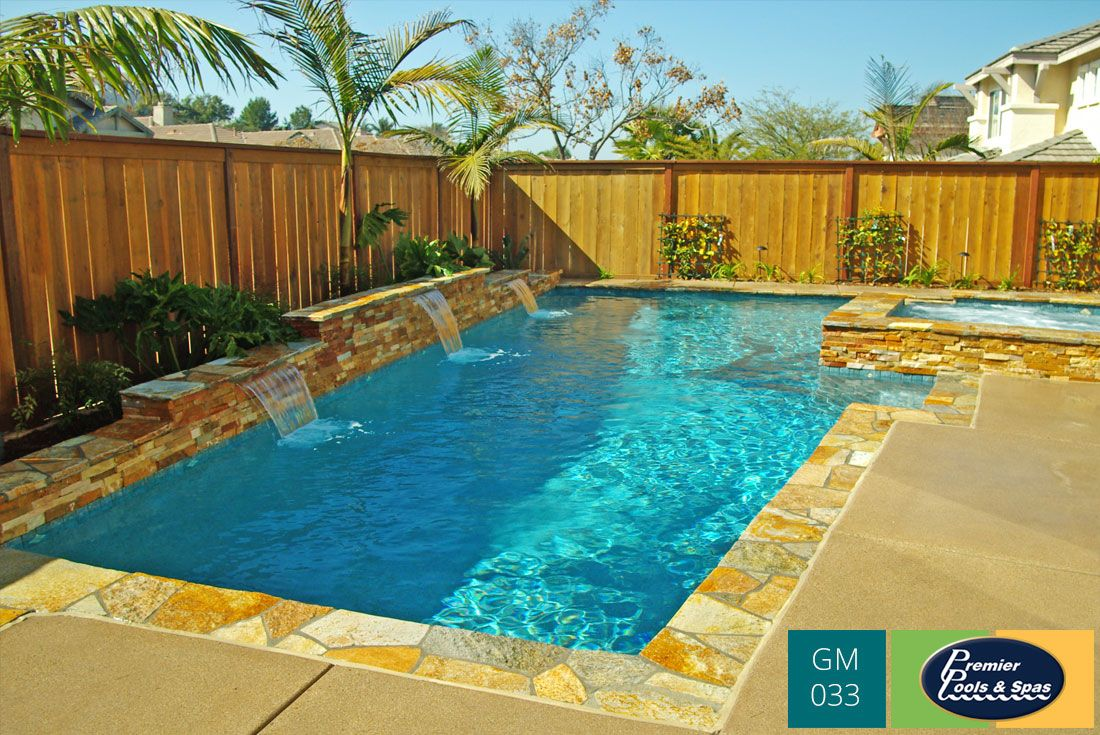 Ledgestone deck coping and sheer descent spillways look great in this backyard swimming pool - Cool backyard swimming pools ...