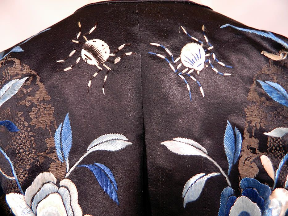 Antique Chinese Blue Silk Damask Weave Dragon Butterfly Spider Embroidered Robe. It is in excellent condition. This is truly a rare and exceptional piece of antique Chinese textile art!    detail view