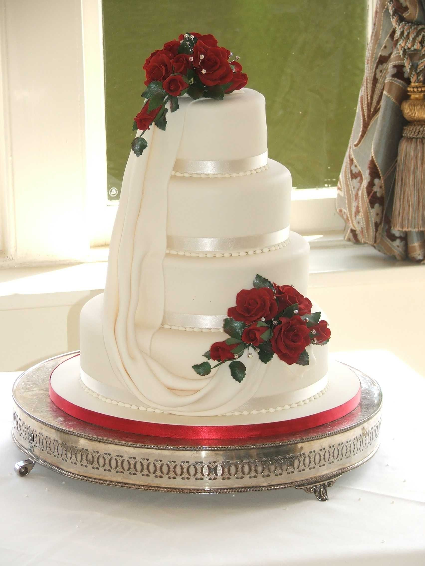 Harriet, 4 tiers with drape and red rose sprays with diamantes ...