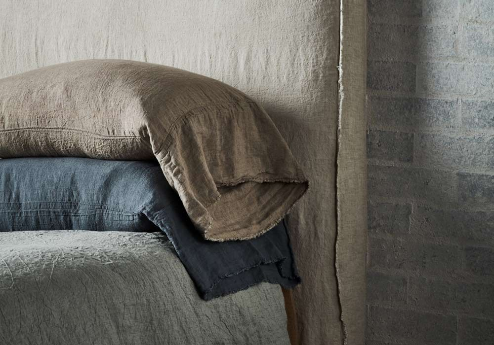 """The Flocca long linen pillowcase features an additional 20cm (8"""") length on the opening edge to create a soft fall when layering."""