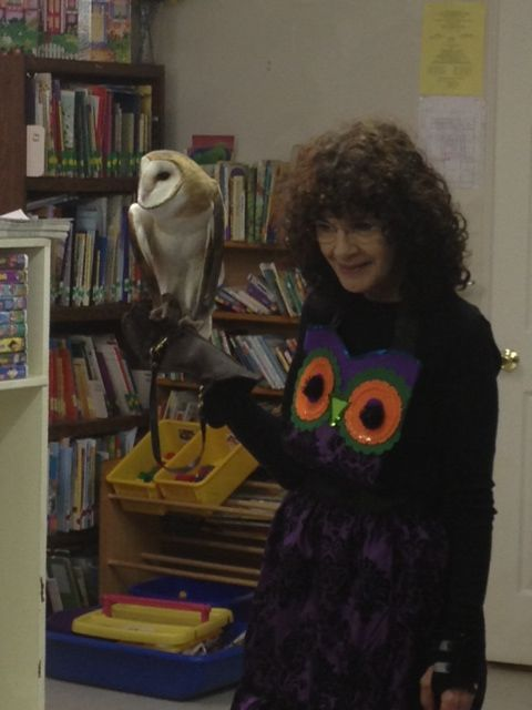 Students are treated to Sandy Beck and her owls.