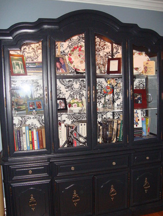 black painted china hutch - but not that wallpaper inside
