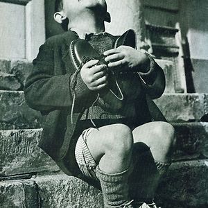Austrian Boy Receives New Shoes During WWII and other historic photographs