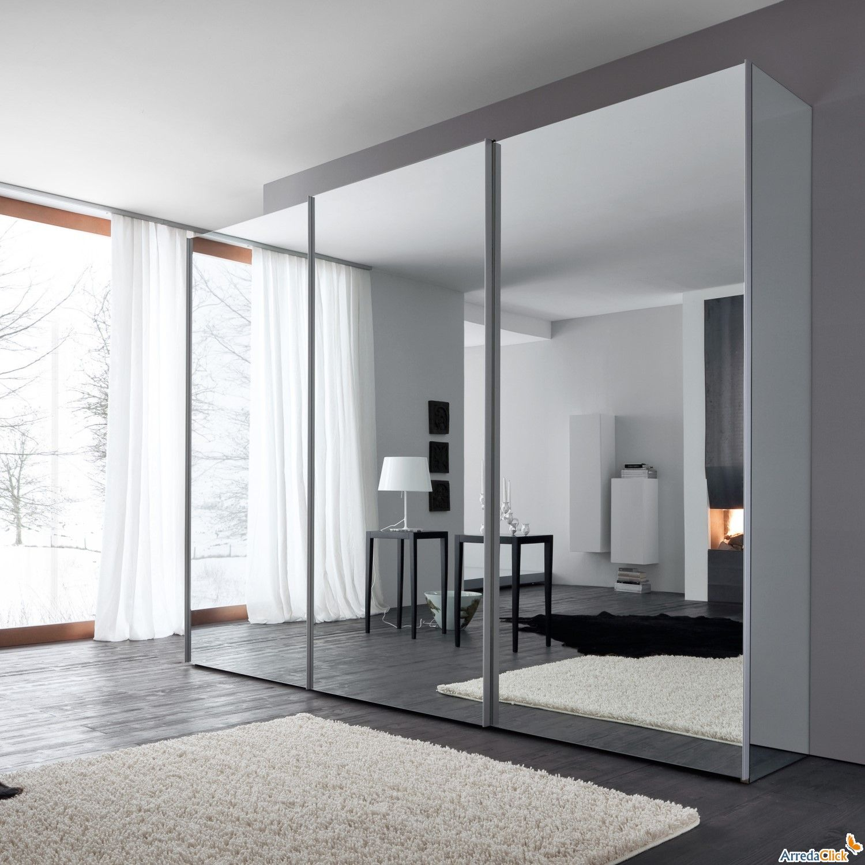 Armario con puertas correderas completo de espejo modelo for Armarios roperos para habitaciones pequenas