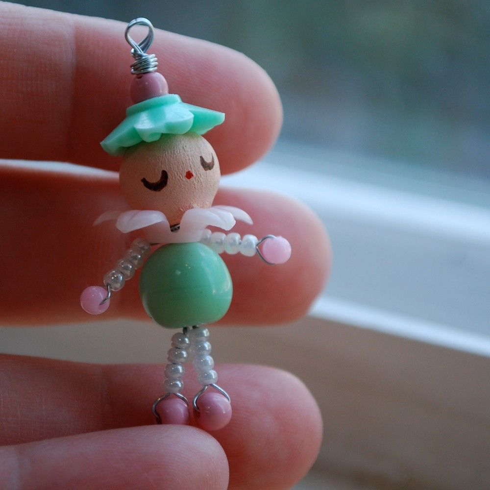 little handmade doll charm pendant ornament - vintage beads - wire wrapped - aqua pink white - hand painted face - lucite glass wood - shabby chic by variation on Etsy https://www.etsy.com/listing/55135038/little-handmade-doll-charm-pendant