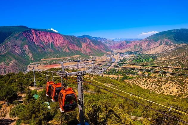 """Glenwood Springs is one of """"The 20 Best Small Towns to Visit in 2013"""" in Smithsonian magazine! This beautiful photo of the tram at Glenwood Caverns Adventure Park is by Blaine Harrington."""