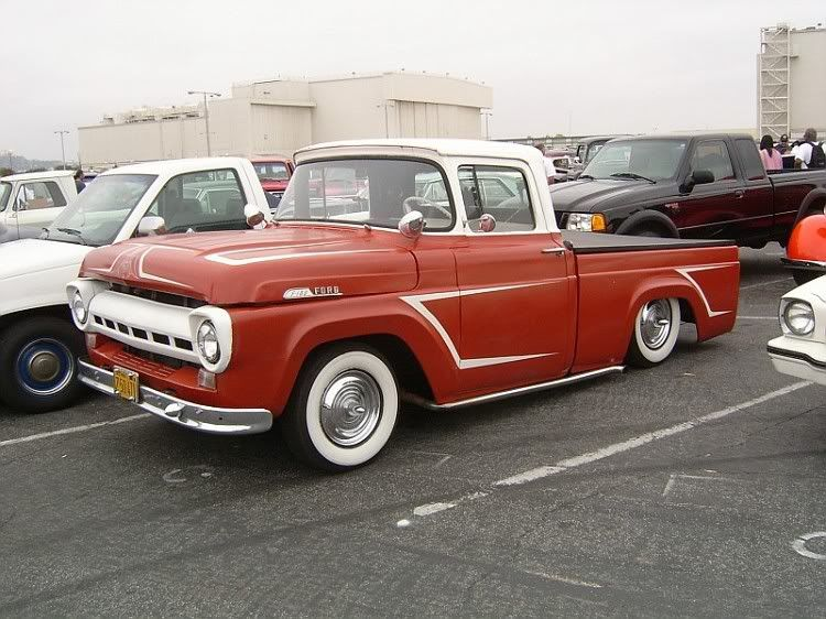 Red White 1957 Ford F 100 Pickup Truck With Lowered Back With Images Custom Trucks Vintage Pickup Trucks Ford Pickup Trucks
