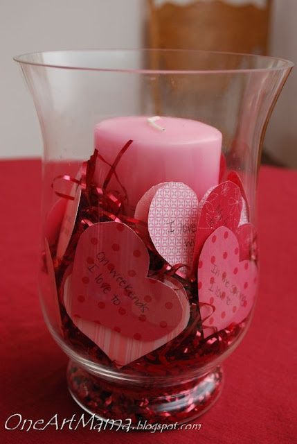Valentine centerpiece - pretty, but you would really want to watch a burning candle with all those paper hearts!