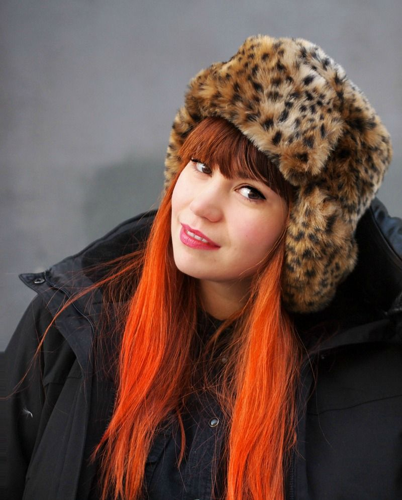 Animal hat, red hair and pink lipstick