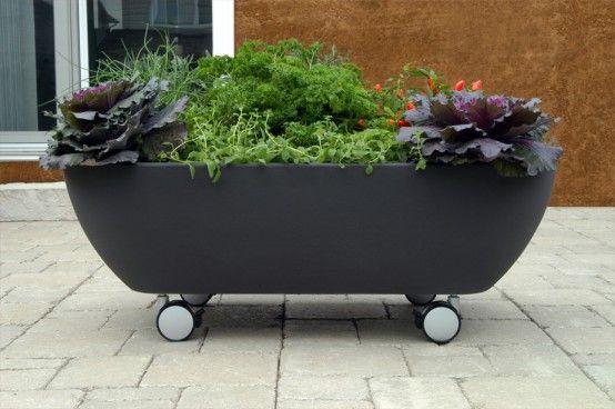 Mobile Bathtub Like Planter To Organize A Mobile Garden Design