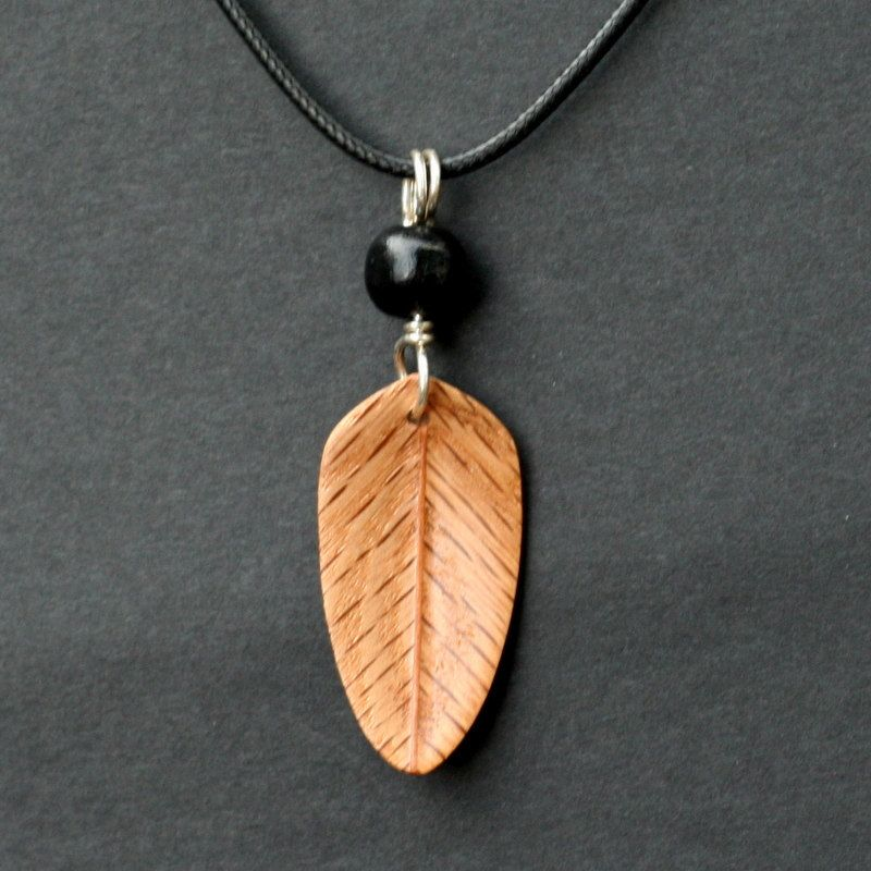 Handcarved Red Oak and Mahogany Wood Leaf / by whittlersroost.  He did a nice job on this feather.