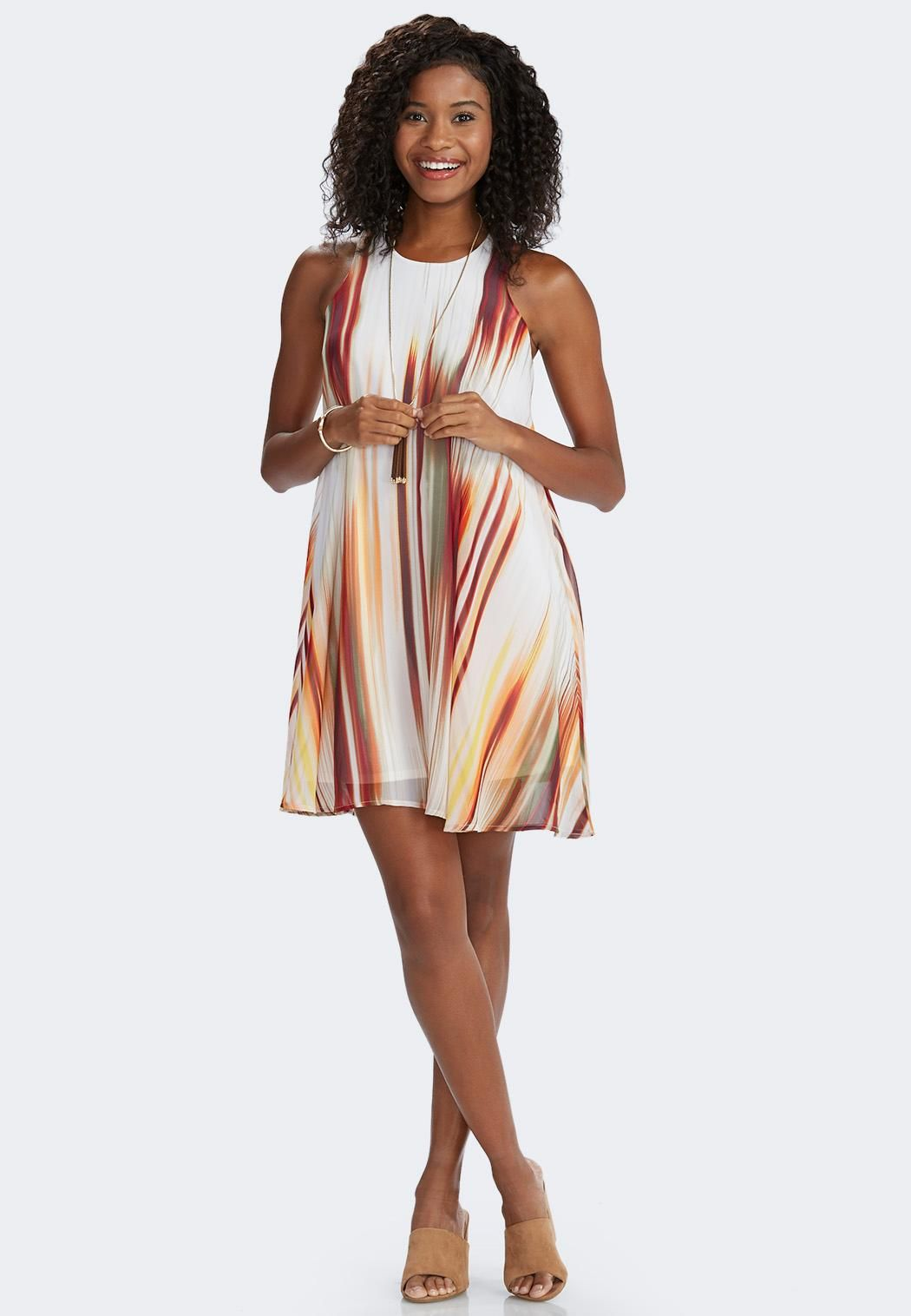 Splash into the season with spice with this stunning swingdress