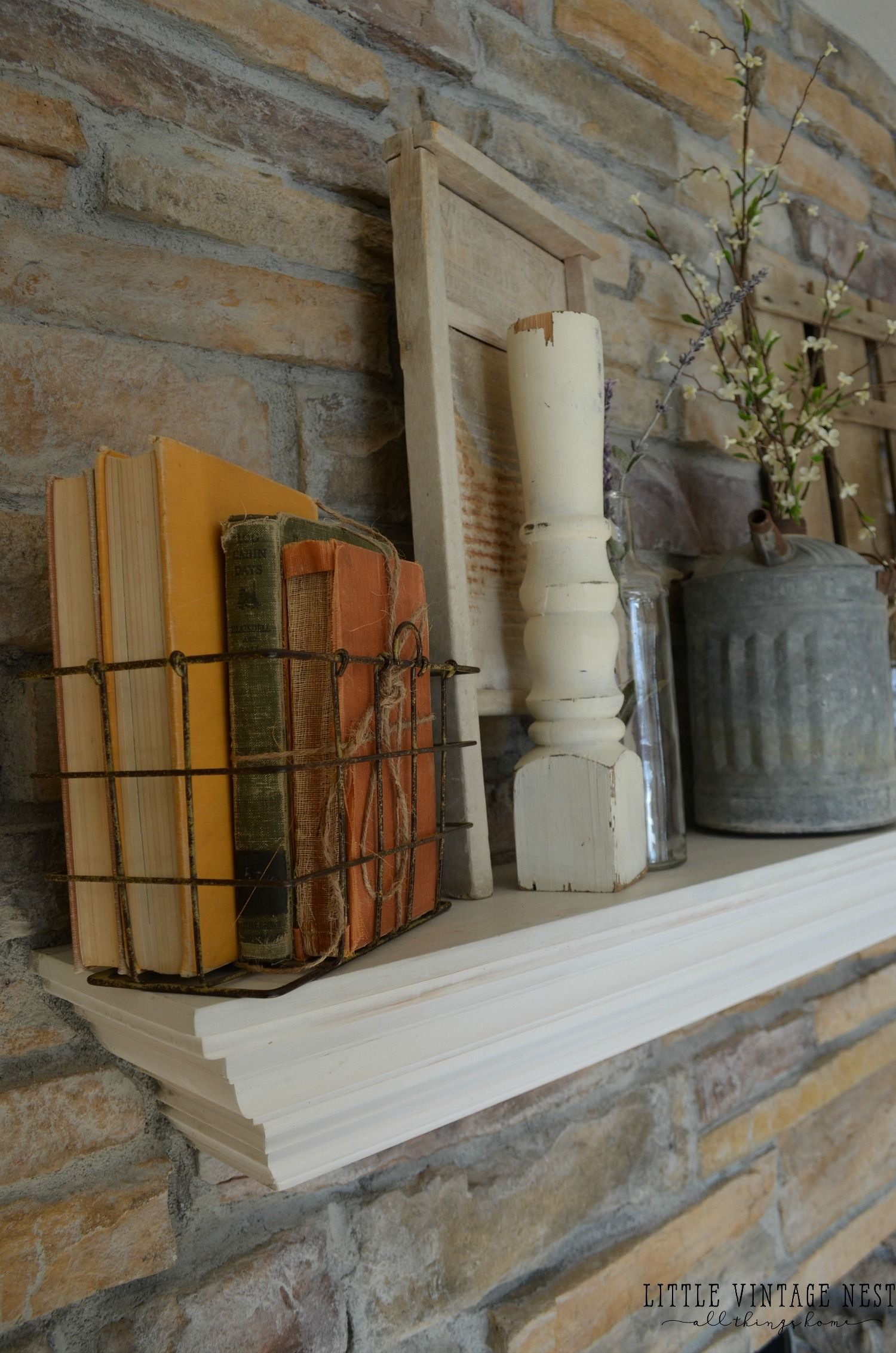 Vintage Farmhouse Spring Mantel With Old Books And Spindles