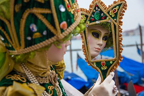 Venetian mask is mirrored in the Carnival of Venice