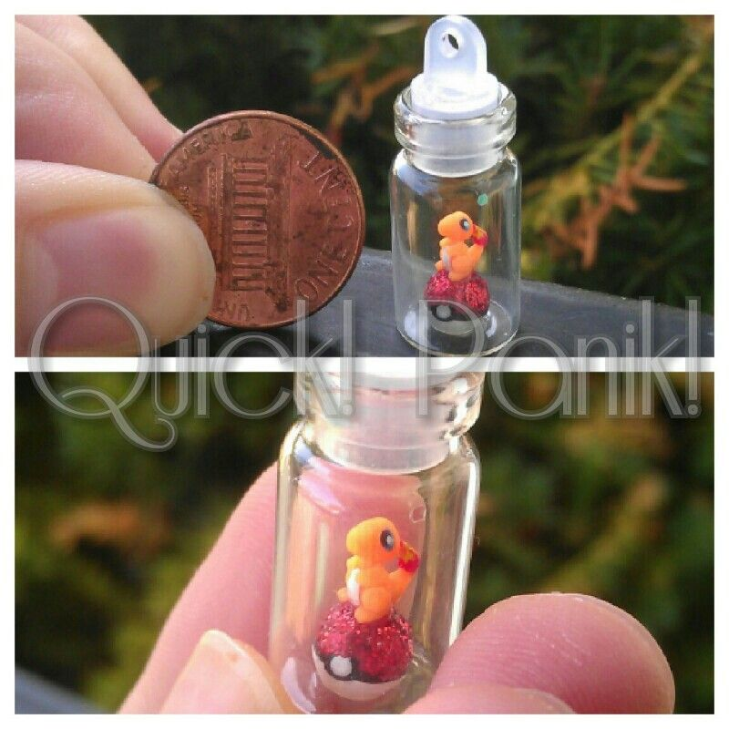 Polymer clay Charmander. From Pokemon. Micro sized :3 kawaii style. Sitting ontop of a glittery topped pokeball. Etsy.com/shop/quickpanik