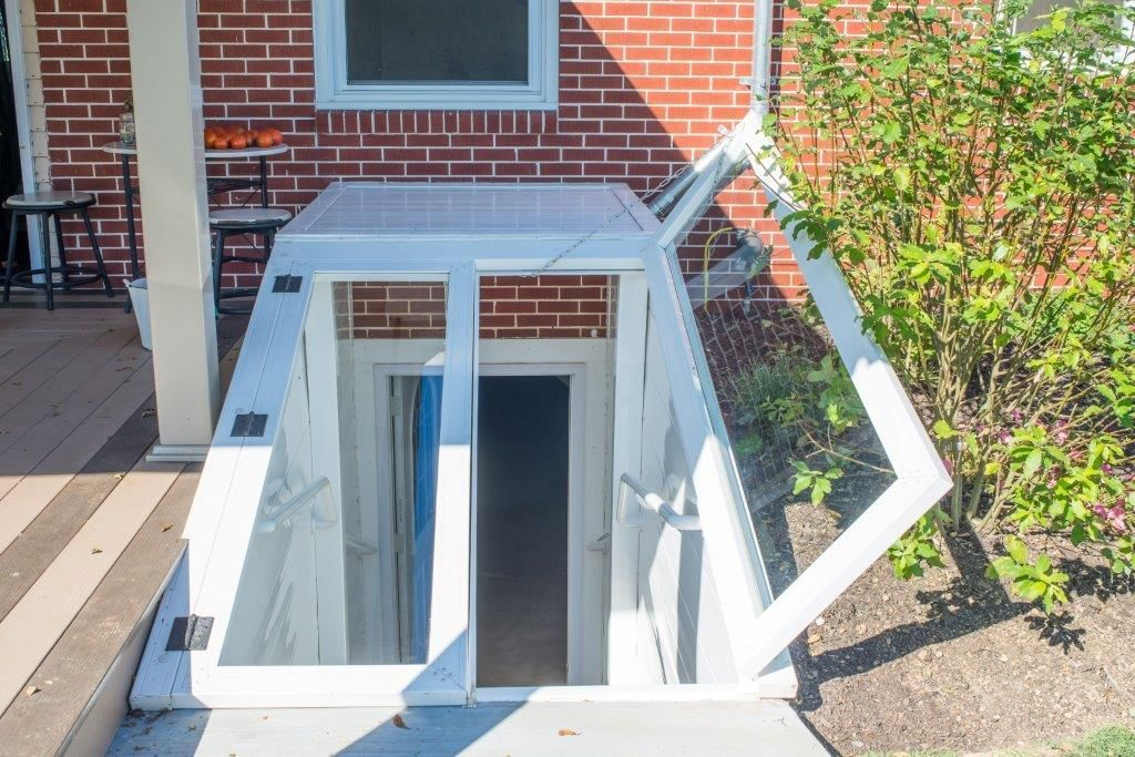 Basement stairway cover by vinyl window wells 7177680618