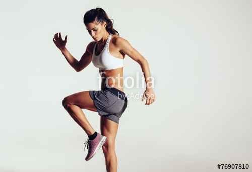 """Laden Sie das lizenzfreie Foto """"Attractive fit woman exercising in studio with copyspace"""" von Jacob Lund zum günstigen Preis auf Fotolia.com herunter. Stöbern Sie in unserer Bilddatenbank und finden Sie schnell das perfekte Stockfoto für Ihr Marketing-Projekt!"""