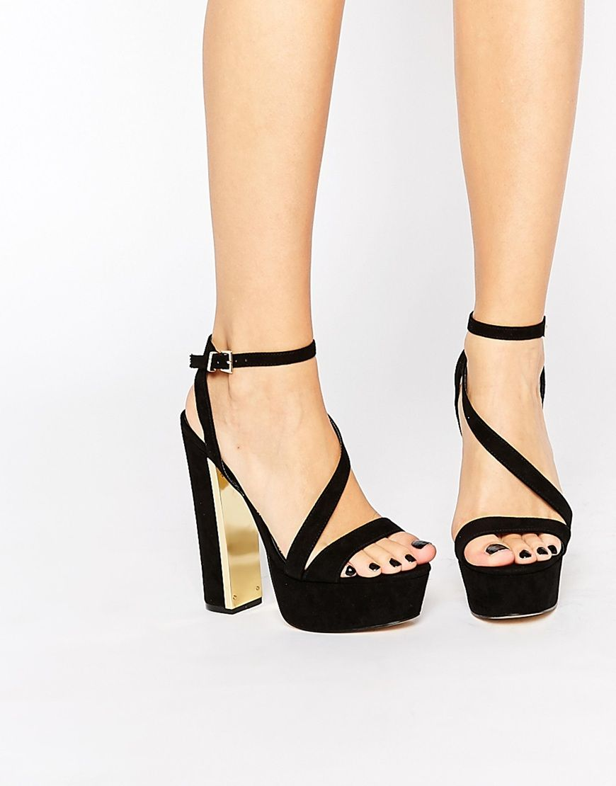 Shop Lipsy Billie Black & Gold Metal Detail Platform Heeled Sandals at ASOS.