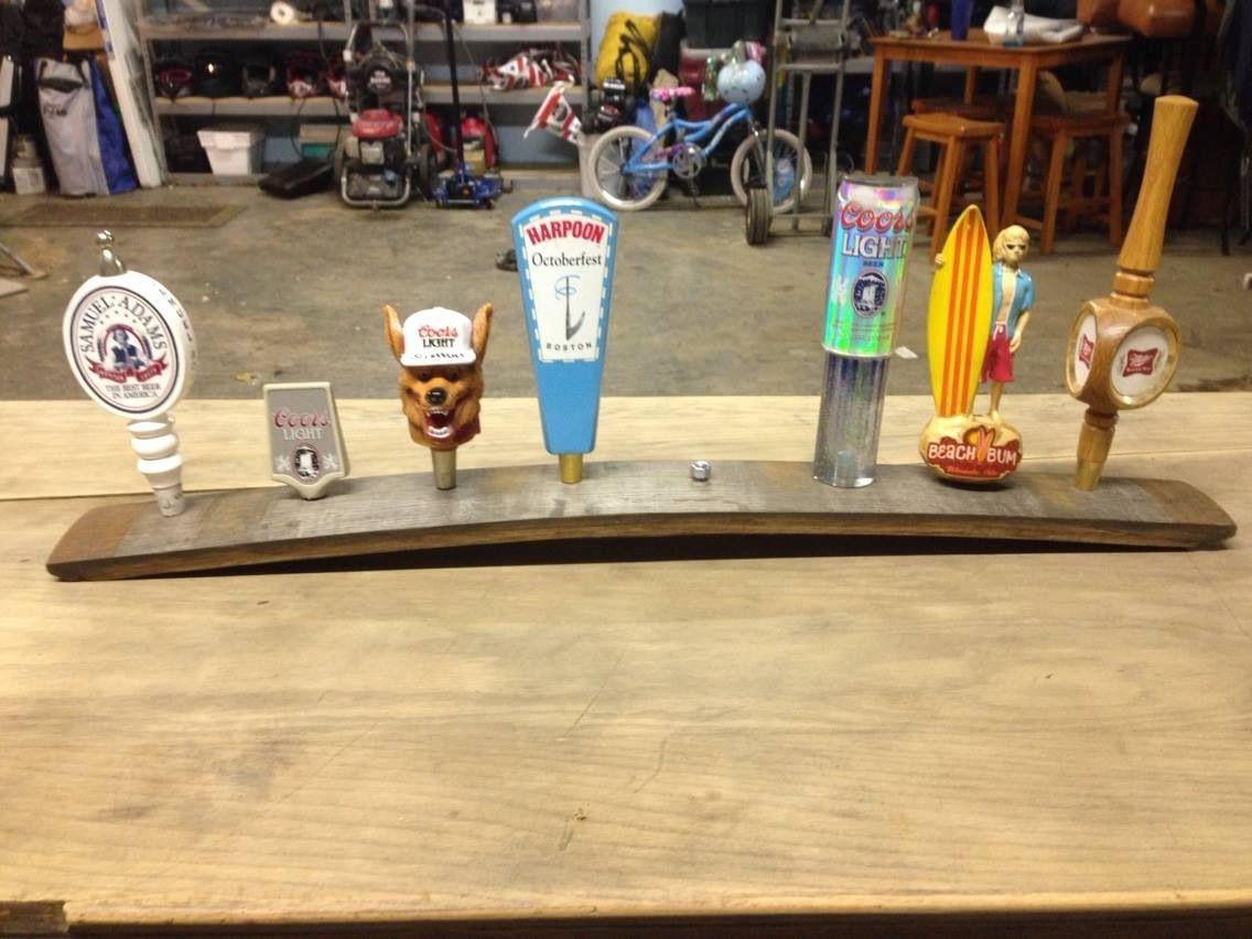 Beer tap display on whiskey barrel board beer tap