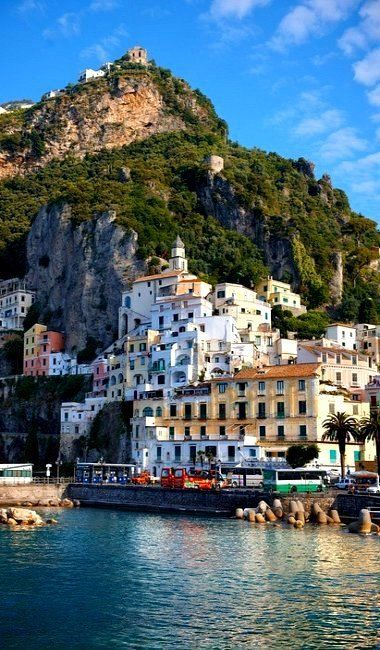 The Amalfi Coast ~ is a coastline on the southern coast of the Sorrentine Peninsula in southern Italy.