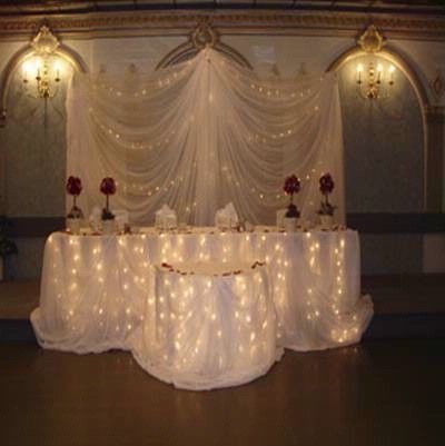 Sweetheart Table And Fabric Backdrop