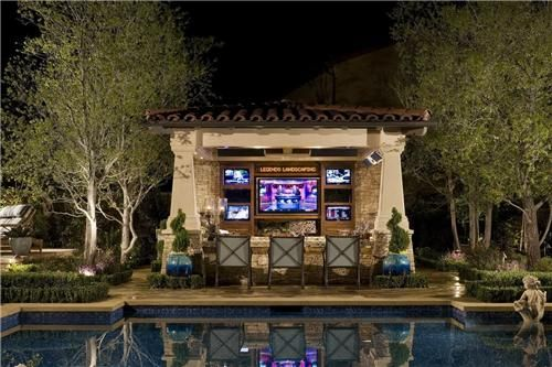 watch the big game from the pool this outdoor entertainment center designed by ams landscape