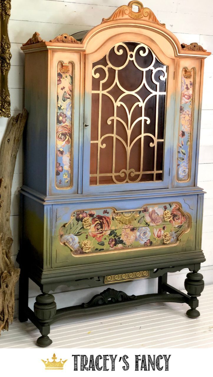 Color Washed Floral Ombre China Cabinet is part of Furniture makeover, Paint furniture, Furniture, Painted furniture, China hutch, Shabby chic furniture - Watch how Tracey from Tracey's Fancy turns an old hutch into this floral ombre china cabinet with Dixie Belle Paint and design transfer from ReDesign