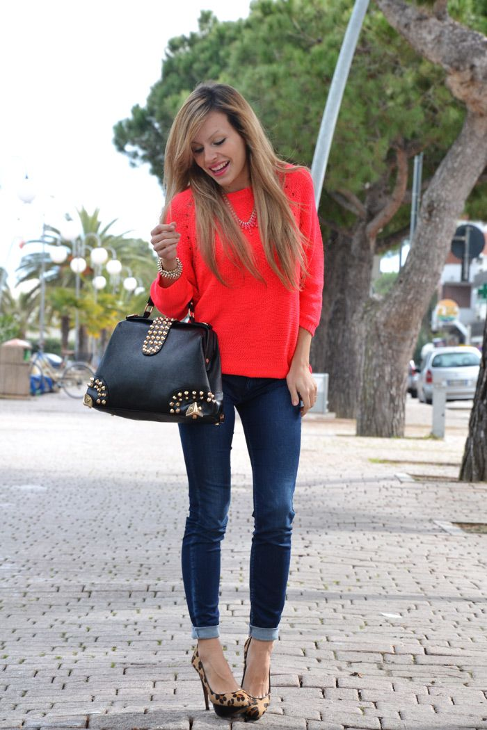 Bright orange sweater, cheetah heels