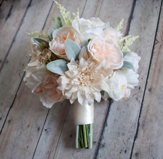 A soft and elegant wedding bouquet with blush pink and ivory garden roses, dahlias, and peonies, accented with soft green lambs ear. This wedding
