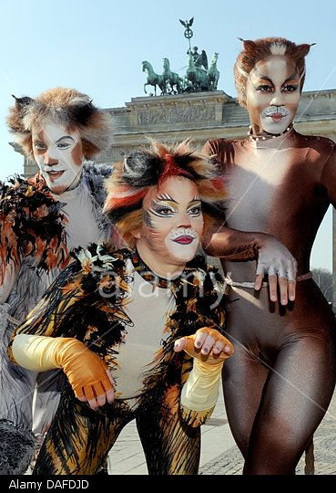 Members Of The Ensemble Of Musical 'cats' pose In Front Of