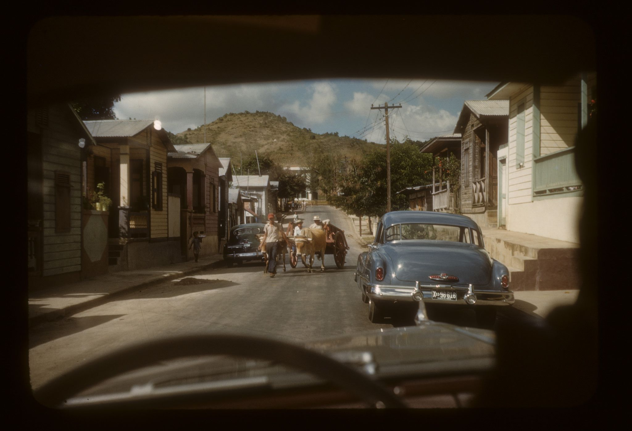 https://flic.kr/p/qHDQMk | CB38--Ox team pulling cart on Aibonito street | Puerto Rico. Clarence Baer photo.