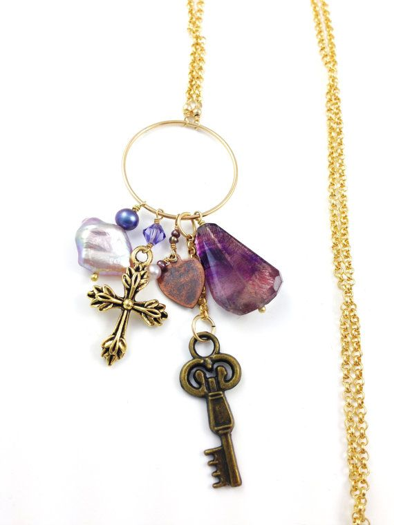 """This elegant necklace a cluster of colorful purple charms dangle of gemstones, swarovski crystal and various sterling silver shape from a 14k gold fill circle and chain 28"""" in length. Pair it with a beautiful dress and you're ready to go.  Handmade by myself, Stacee Gillelen."""