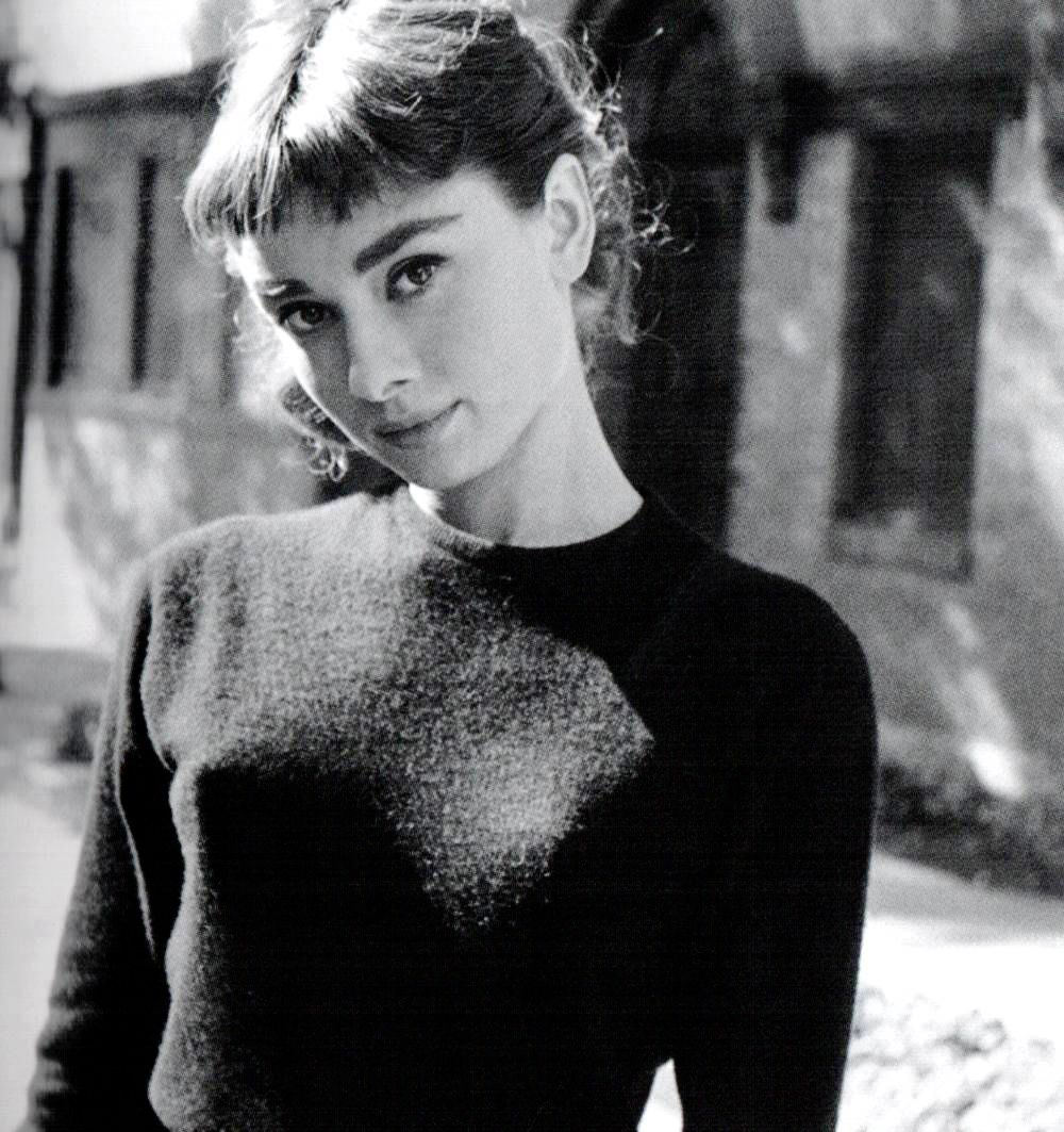 Audrey Hepburn rides her bike around the Paramount lot during the filming of Sabrina. Photographs by Mark Shaw, 1953.