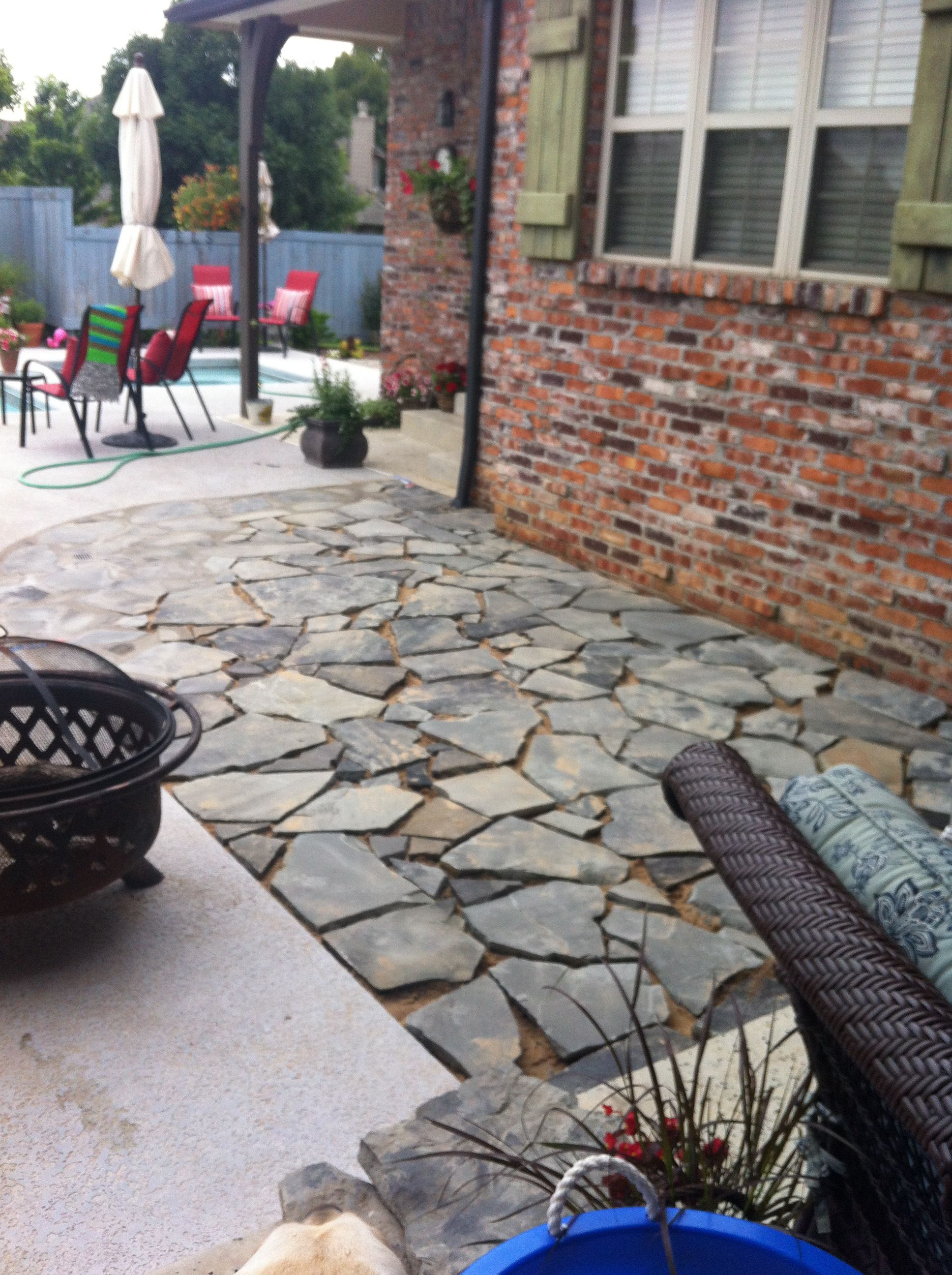 Flagstone that I laid on the right side of the walkway leading from the patio to the pool. This pic was just before I grouted and later sealed the flagstone.