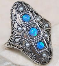 $24.99 Sterling silver sale going on Now!Beautiful Opal ring in Genuine Sterling silver